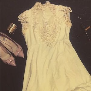 Vintage ivory wedding dress adorned w/ lace/pearls